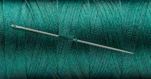 svart knappvisartråd Arkivfoto