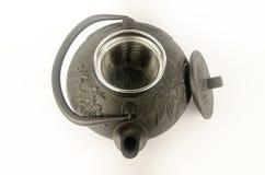 Svart kokkärl för att brygga te Arkivbild