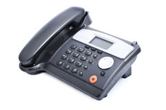 svart kontorstelefon Arkivfoto
