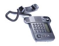 Svart kontorstelefon. Arkivbild