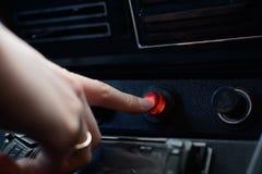 Svart kontrollbord i en rysk bil med en knapp f?r n?d- stopp royaltyfri foto
