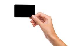 Svart kort i kvinnas hand Arkivbild