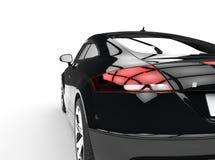 Svart kraftig bil på den vita bakgrundsbaksidasikten Arkivbilder