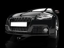 Svart kraftig bil på svart bakgrund Arkivbilder