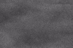 Svart äktt läder, closeupbakgrundstextur Arkivfoton