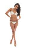 Svart kvinna i den vita bikinin Fotografering för Bildbyråer