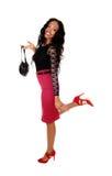 Svart kvinna med handväskan Royaltyfri Bild