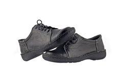 svart läder över s shoes vita kvinnor Royaltyfri Bild