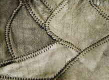 svart läderpatchwork Arkivbild