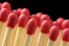 svart linje röda matchsticks för bakgrund Royaltyfria Bilder