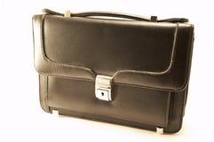 svart liten resväska Arkivbilder