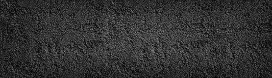 Svart målad bred textur för stenvägg Panorama- bakgrund för mörk grov pebbledash royaltyfri fotografi