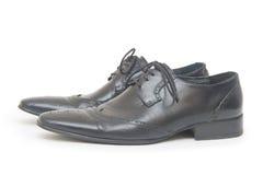 Svart man skor som isoleras på vit bakgrund Royaltyfria Foton