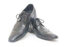 Svart man skor som isoleras på vit bakgrund Royaltyfri Fotografi
