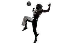 Svart manfotbollspelare som jonglerar fotbollkonturn Royaltyfri Fotografi