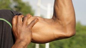 Svart manlig idrottsman nen And Muscles arkivfoto