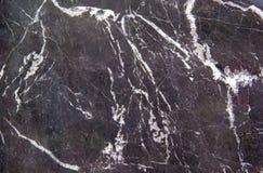 Svart marmorerar textur med den naturliga modellen för delikata åder för bakgrund eller bakgrund royaltyfria foton