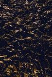Svart med guld- abstrakt bakgrund Royaltyfria Bilder