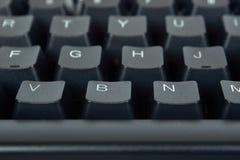 Svart mekaniskt datortangentbord Makrobilden, teknologibakgrund, slut knäppas upp arkivfoton
