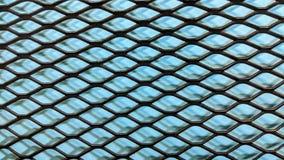 Svart metalliskt galler på ljus - bakgrund för blått papper royaltyfri illustrationer