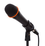 Svart mikrofon med kabel på ställning Royaltyfri Foto