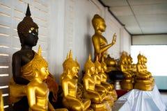Svart och guld- Buddha Fotografering för Bildbyråer