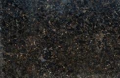 Svart och guld mönstrat naturligt av mörk marmorbakgrundstextur för design arkivbild