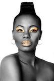 Svart och guld- skönhetframsida Royaltyfri Bild