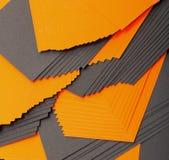 Svart och orange arkpapper royaltyfria bilder