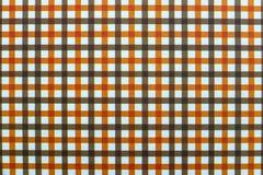 Svart och orange rutig sömlös textur av tapeten royaltyfria bilder