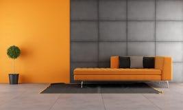 Svart och orange vardagsrum Arkivbild