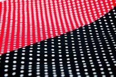 Svart och röd tisuue med vita prickar Fotografering för Bildbyråer