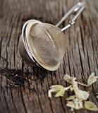 Svart och växt- tea arkivfoton