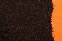 svart orange tea för bakgrund arkivbild