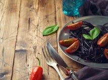 Svart organisk spagetti royaltyfri fotografi