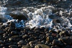 svart pebble för strand Royaltyfri Bild