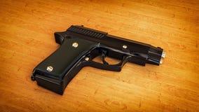Svart pistol på träbakgrund arkivbild