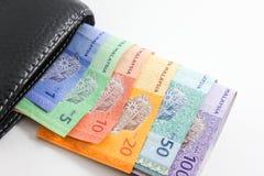 Svart plånbok med Malaysia ringgitsedlar Fotografering för Bildbyråer