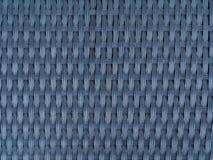 Svart plast- texturerad bakgrund för väv closeup arkivfoton