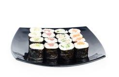 Svart platta av sushi Royaltyfri Bild