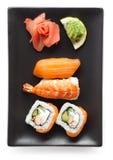 Svart platta med sushi Fotografering för Bildbyråer
