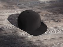 Svart realistiskt lock som isoleras på mörk träbakgrund, tolkning 3d Fotografering för Bildbyråer