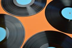Svart rekord för vinyl fyra på apelsinen Royaltyfria Bilder
