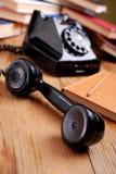 Svart retro telefon royaltyfri foto