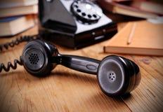 Svart retro telefon arkivbilder