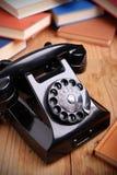 Svart retro telefon royaltyfria foton