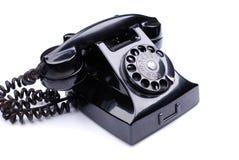 Svart retro telefon arkivfoto