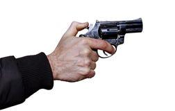 Svart revolver i en isolerad manlig hand Arkivfoto
