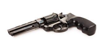 Svart revolver på den vita bakgrunden Fotografering för Bildbyråer