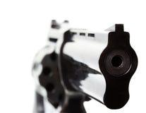 Svart revolver på den vita bakgrunden Arkivbild
